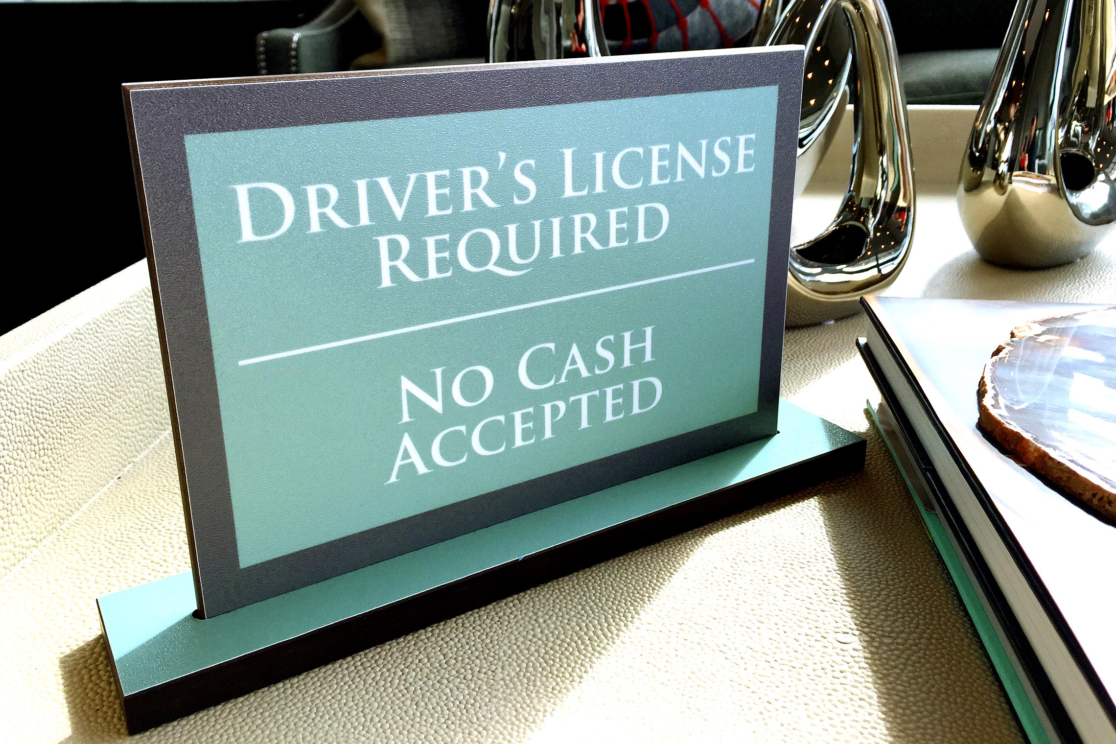 Aura Memorial Driver's License Required No Cash Accepted Desk Set in Leasing Office