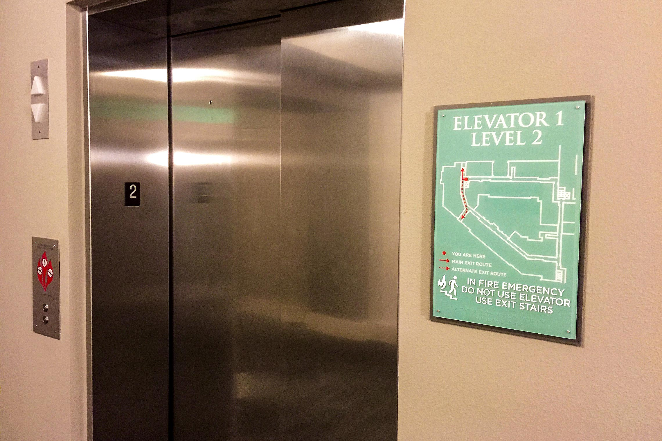 Aura Memorial Evacuation Sign by Elevator with Escape Plan and Direction