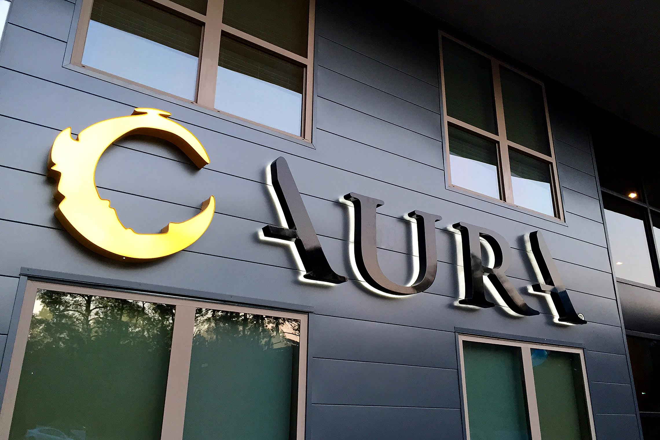 Aura Memorial Illuminated Halo Lit Letters by Leasing Office Night