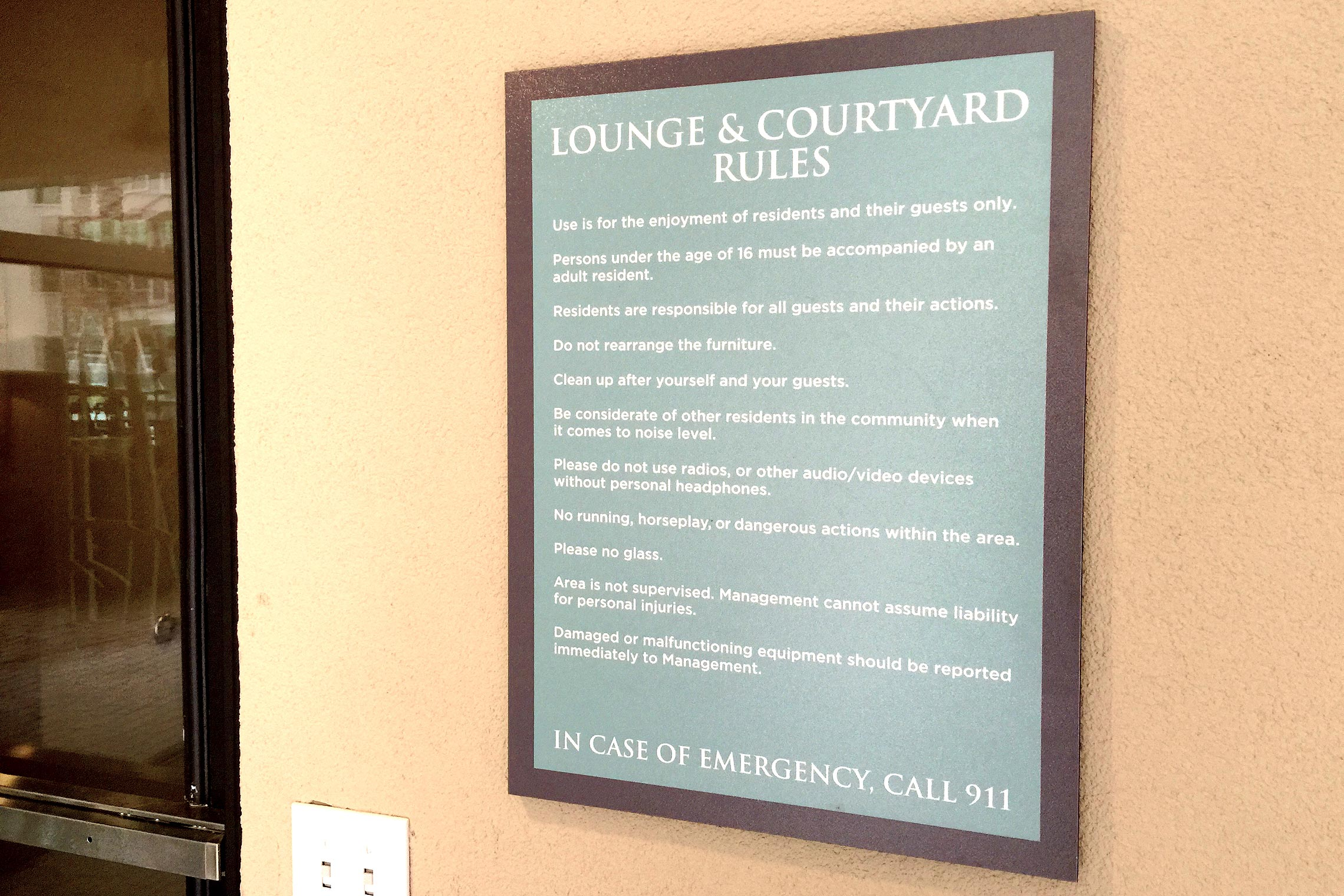 Aura Memorial Lounge & Courtyard Rules Sign