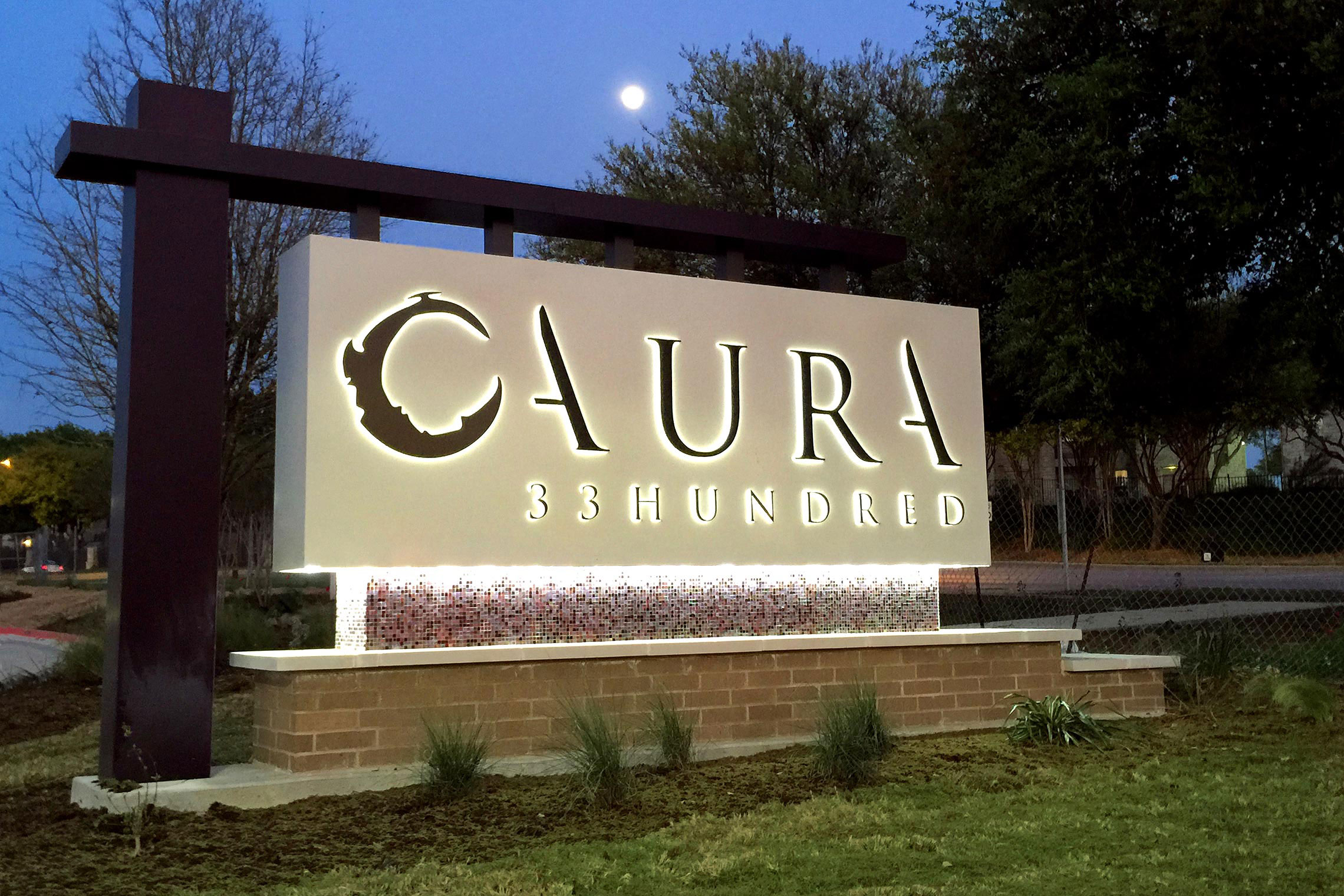 Aura 33hundred contemporary monument robinson creative inc for How much do exterior business signs cost