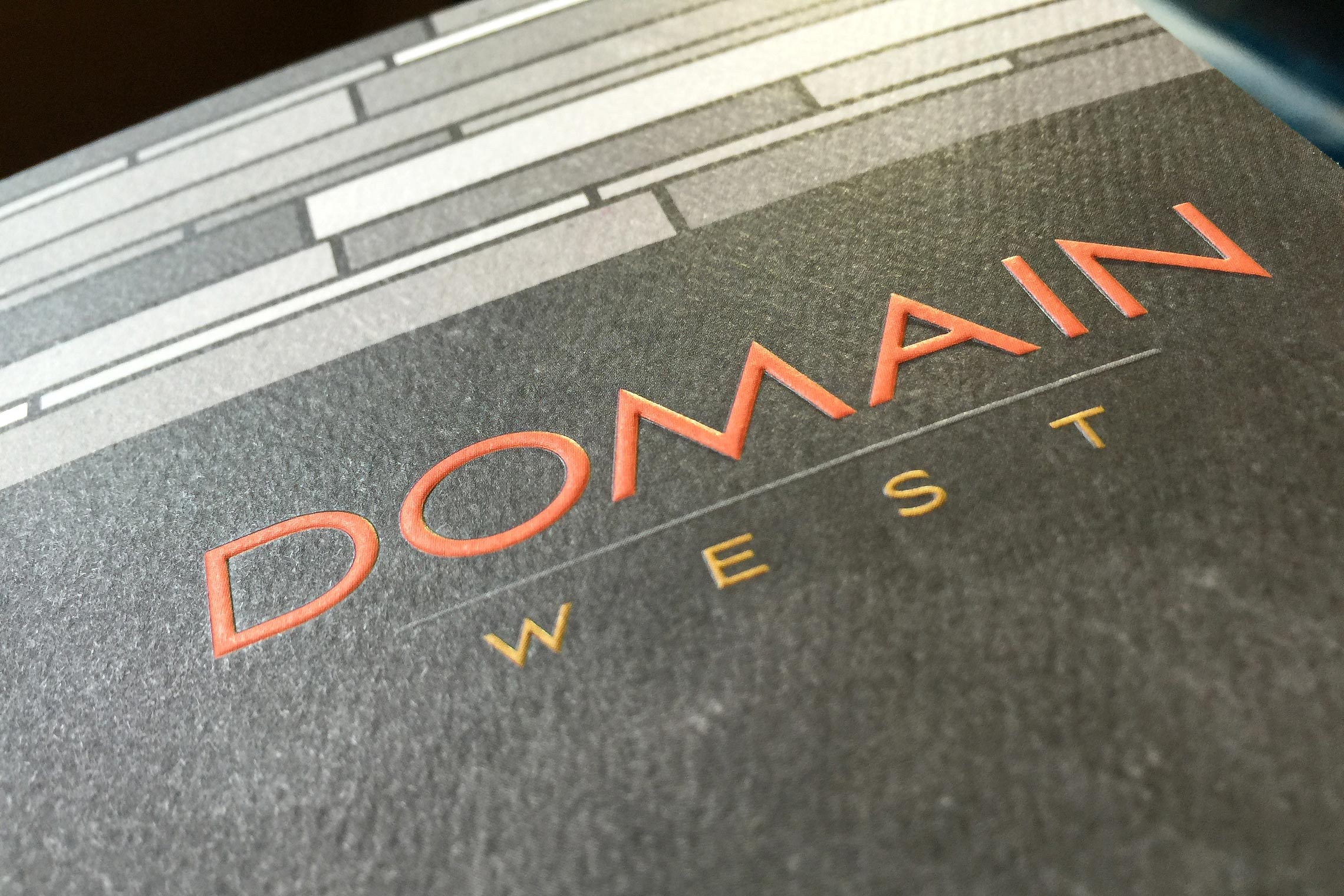 Domain West Custom Collateral - Pocket Folder Brochure Logo Emboss Detail