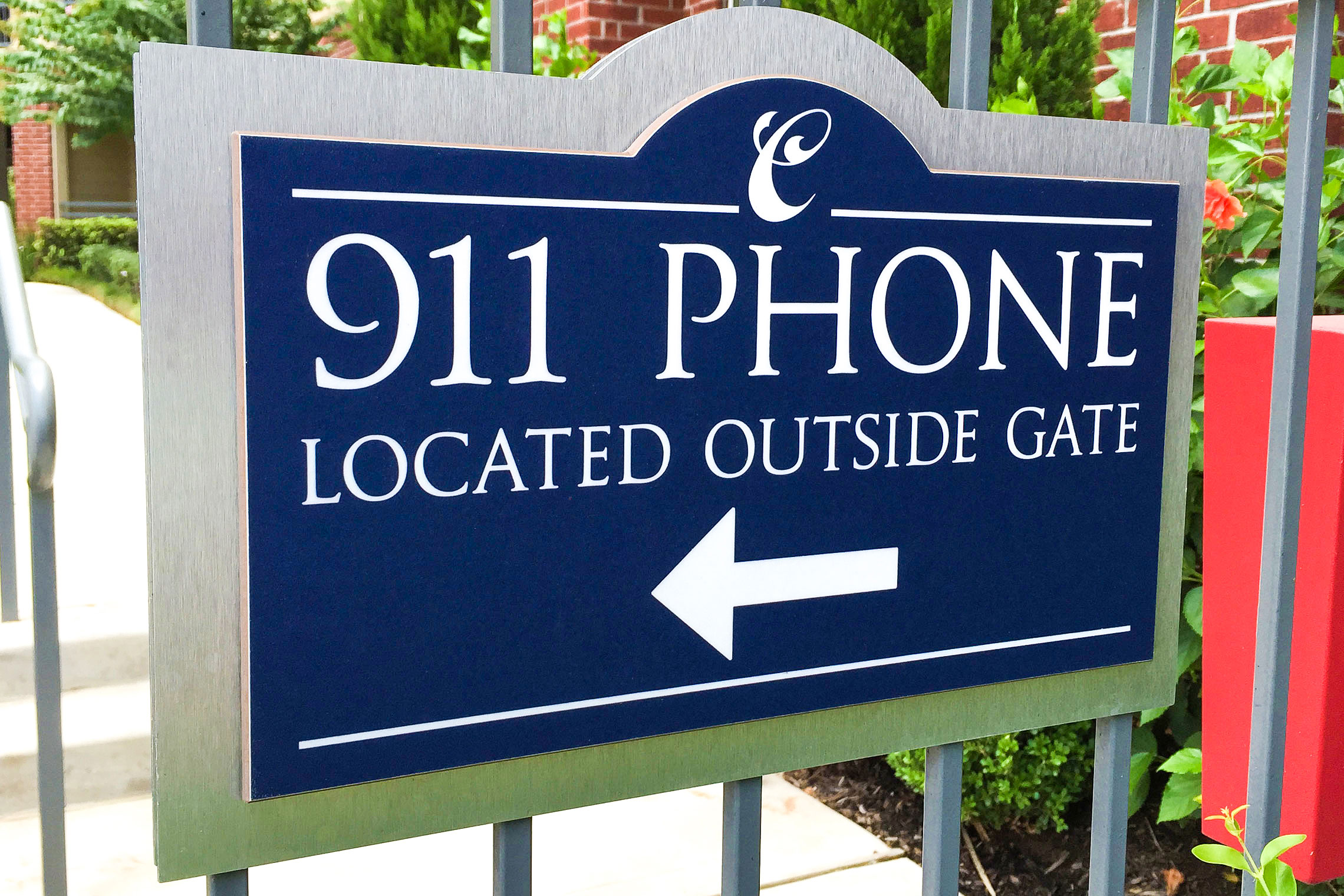 Arium 911 Phone Directional Sign by Pool Gate