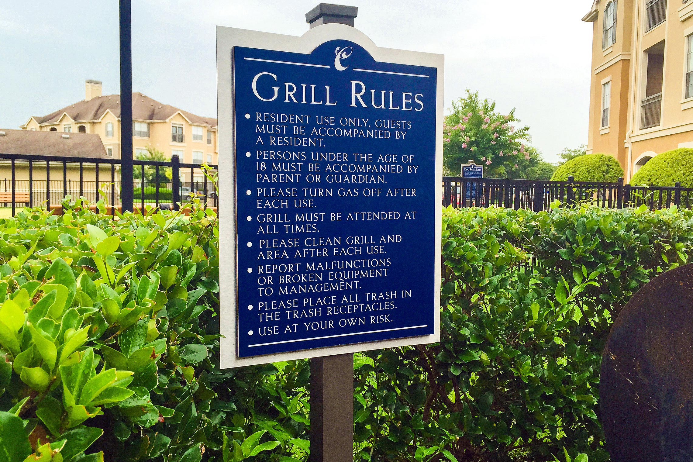Arium Grill Rules Sign on Post