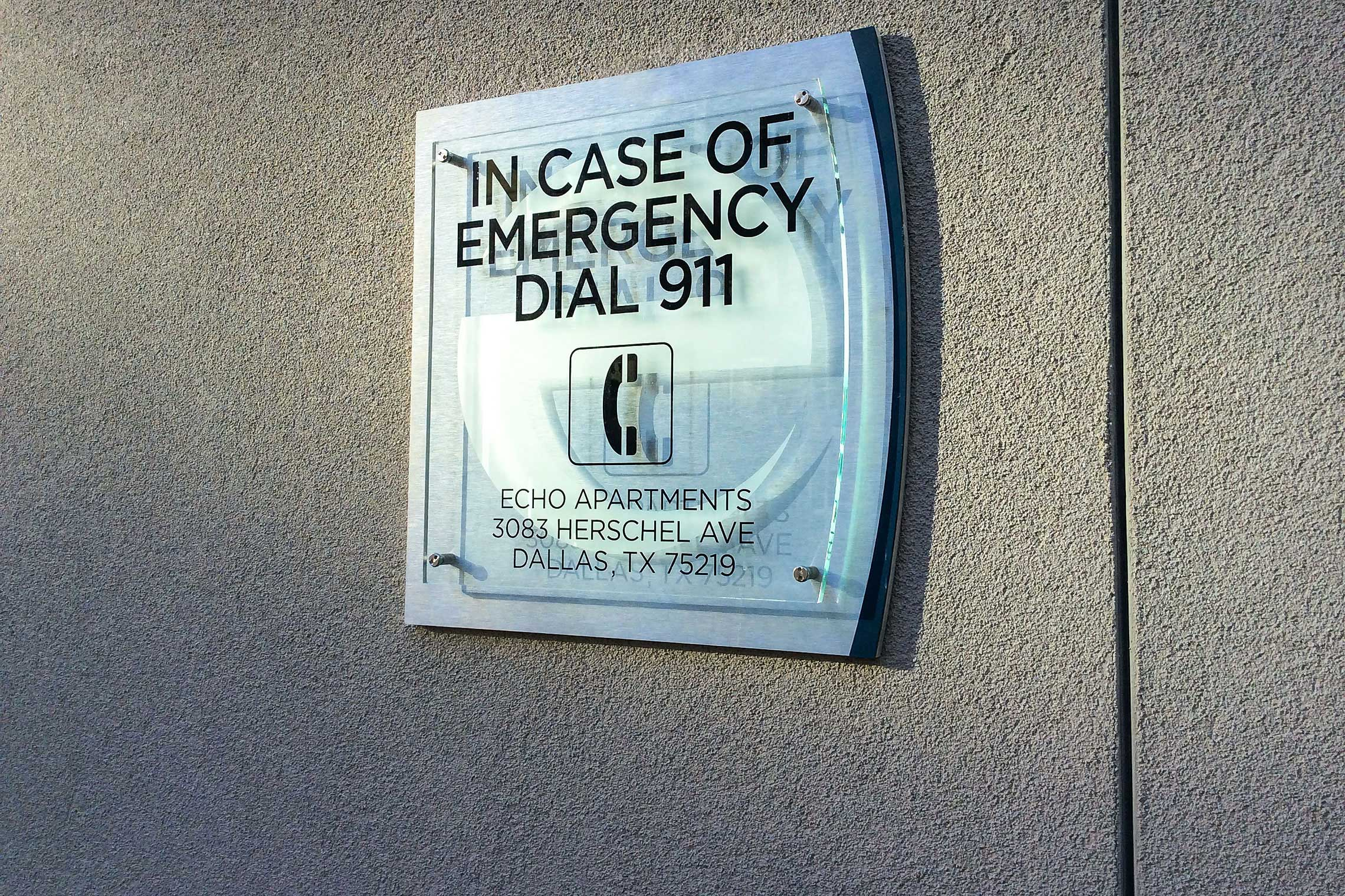 Echo City Apartments In Case of Emergency Dial 911 Sign by Pool
