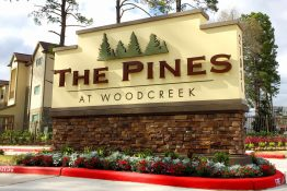 The Pines at Woodcreek Apartments LED Illuminated Monument on Masonry Base