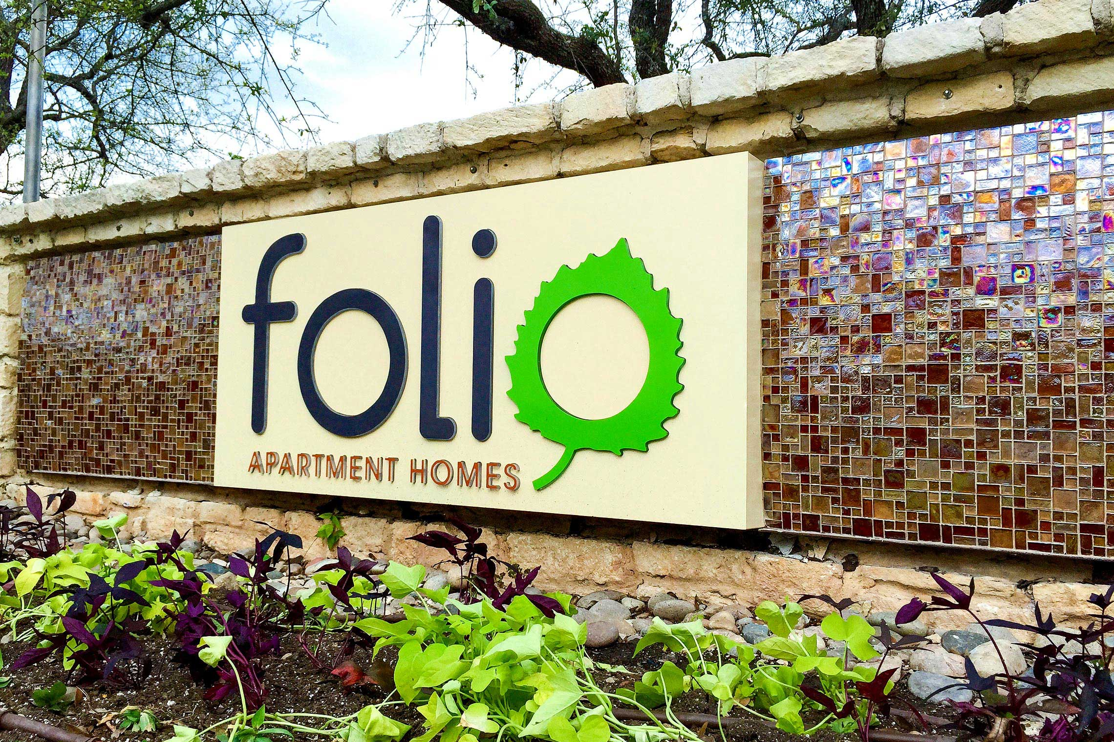 Folio Apartment Homes Illuminated Monument with Tile Accents