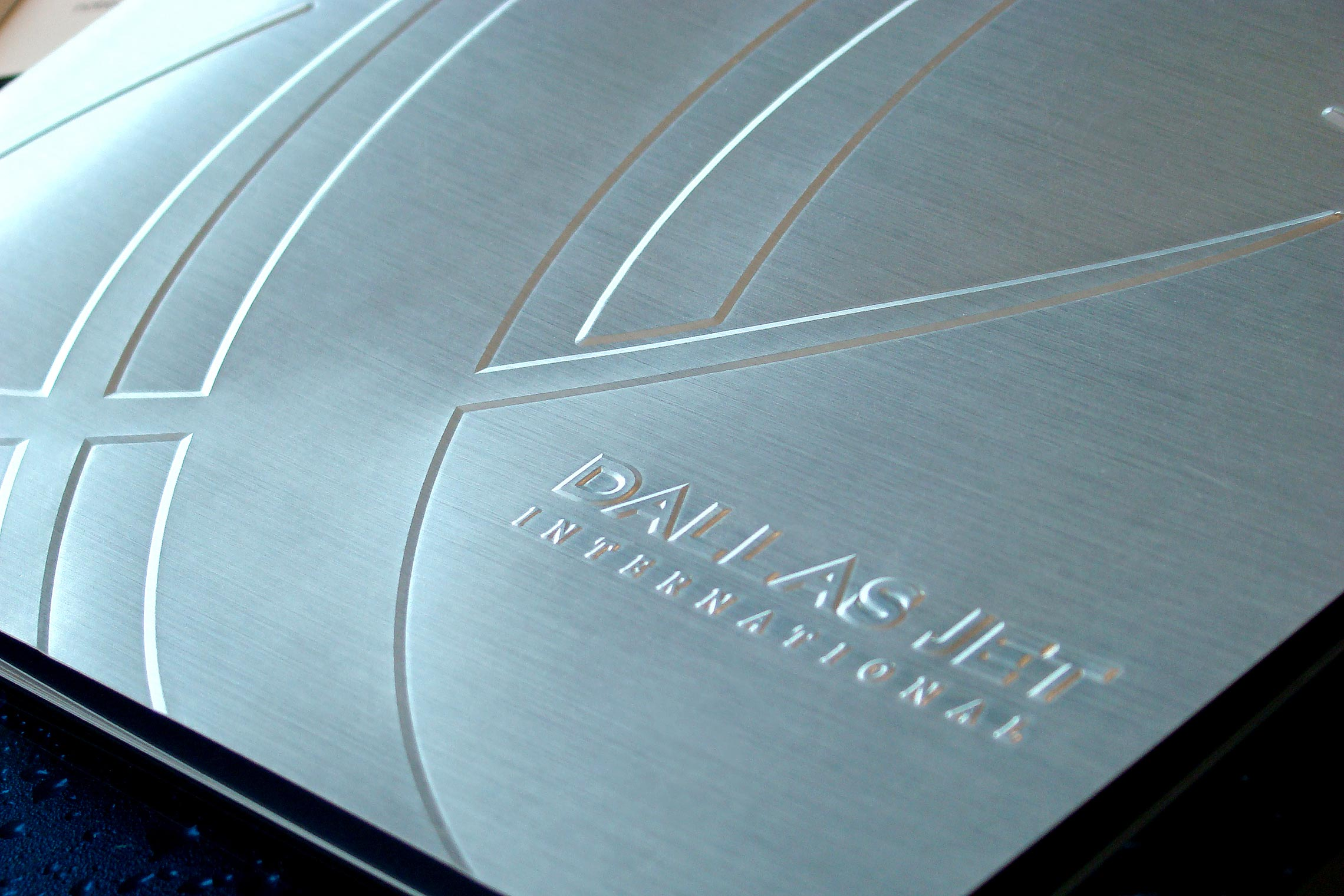 Dallas Jet International Custom Collateral - Pocket Folder Brochure Cover with Emboss Detail