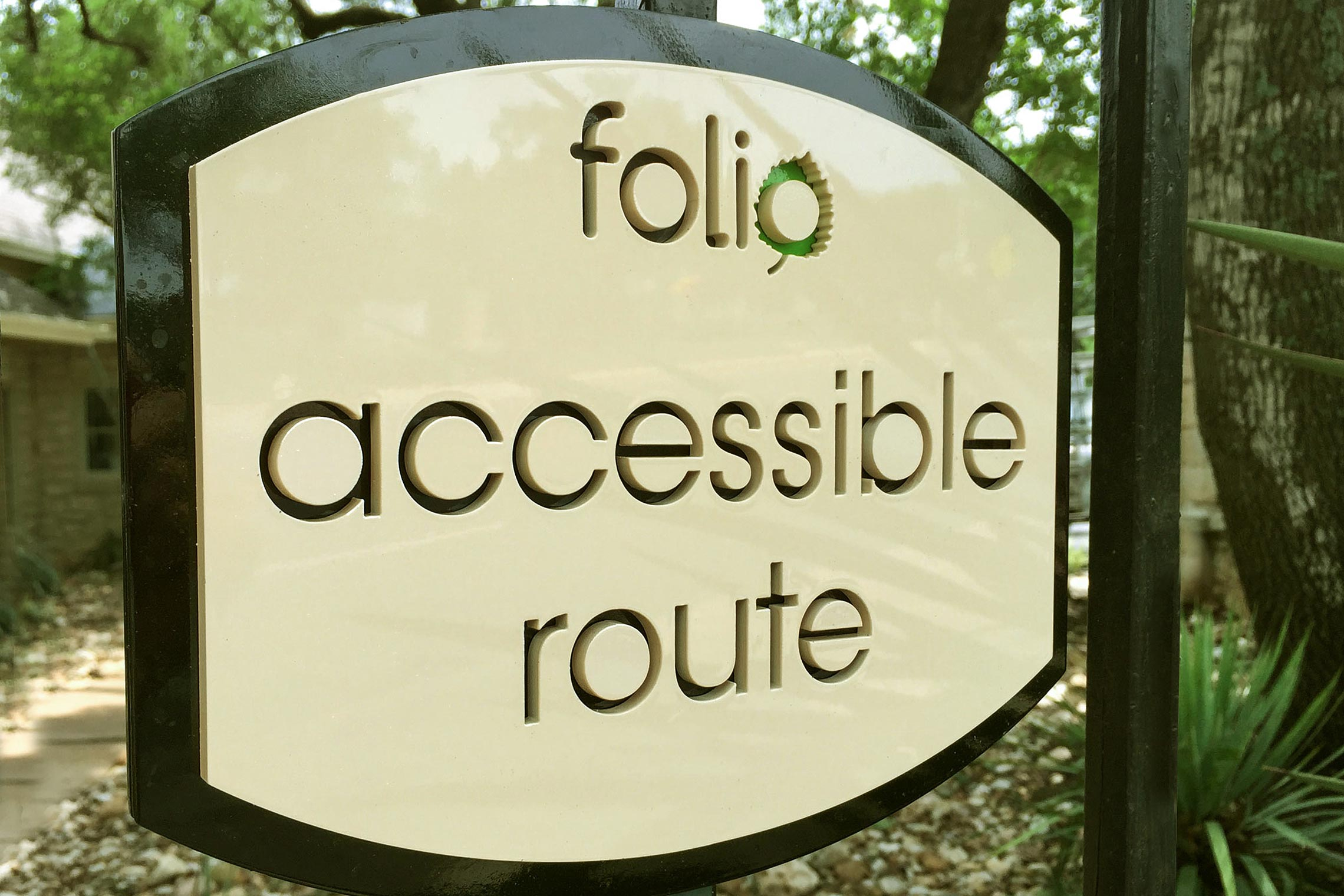 Folio Apartment Homes Accessible Route Sign on Gate