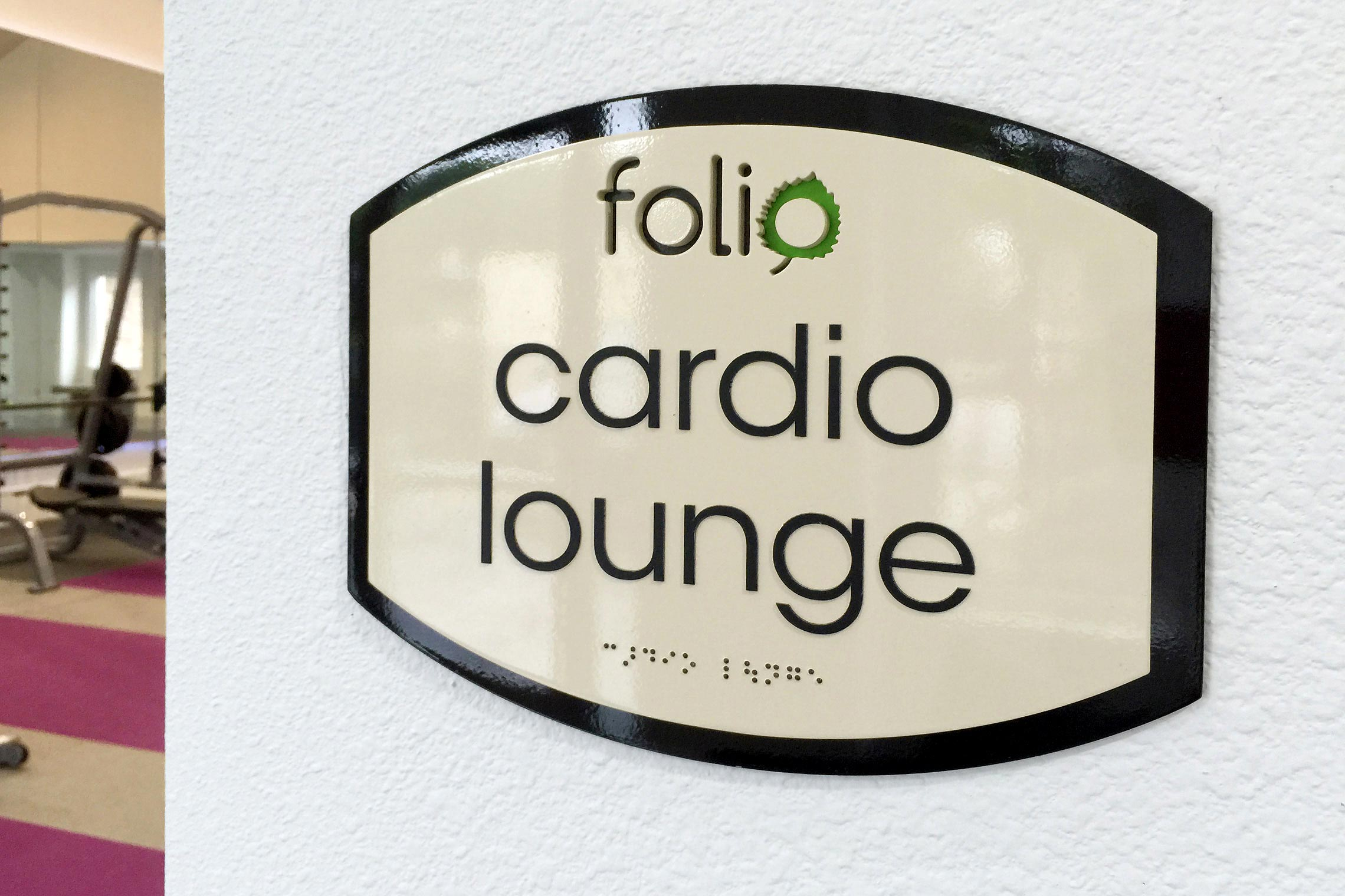 Folio Apartment Homes Cardio Lounge ID with ADA/Braille