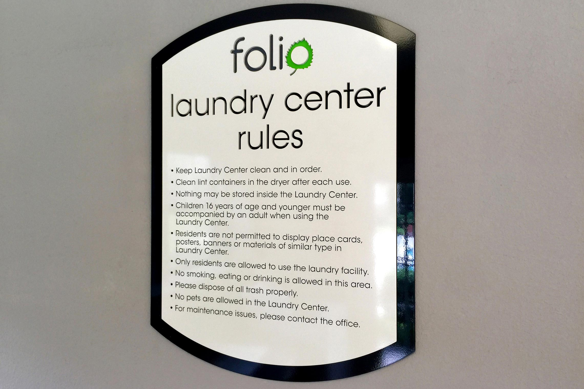 Folio Apartment Homes Laundry Center Rules Sign