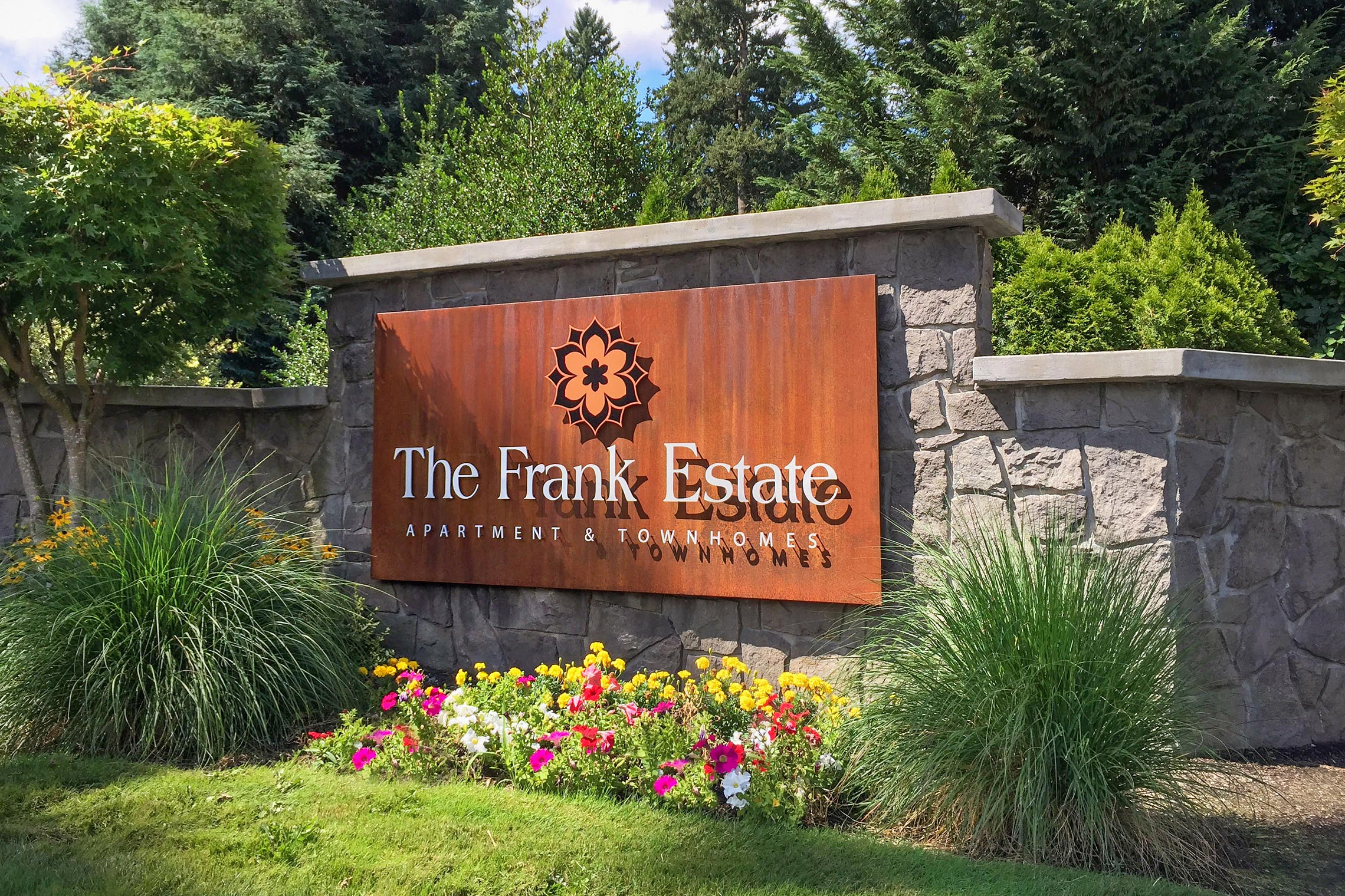 The Frank Estate Apartment & Townhomes Corten Steel Monument with Aluminum Logo Icon
