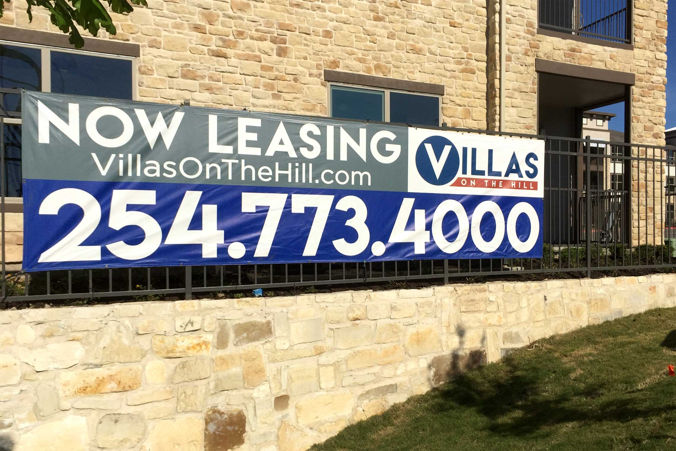 Villas on the Hill Apartments - Temporary Marketing Banner on Fence