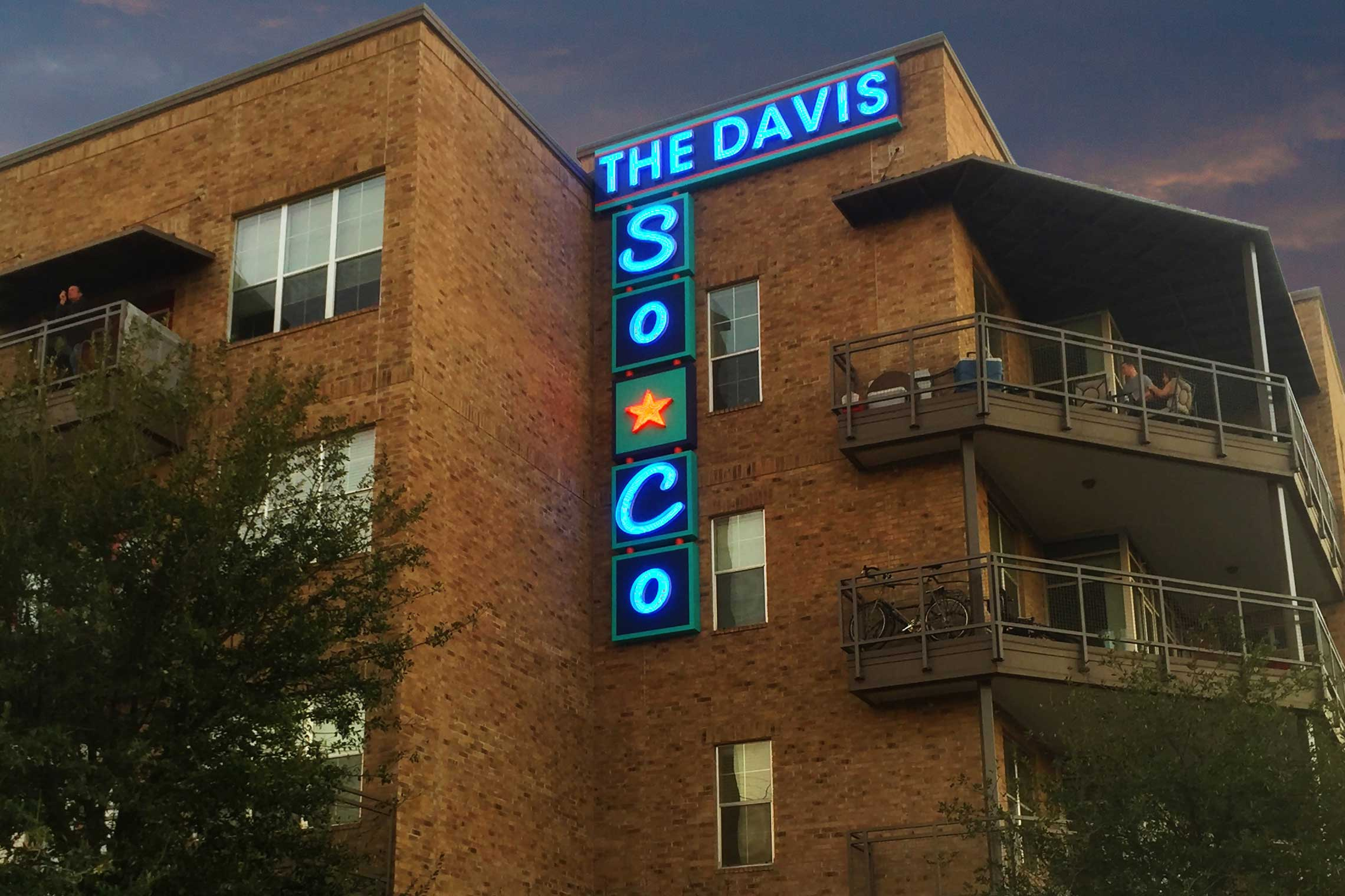 The Davis Soco Urban Industrial Illuminated Neon Wall Identity Sign at Night