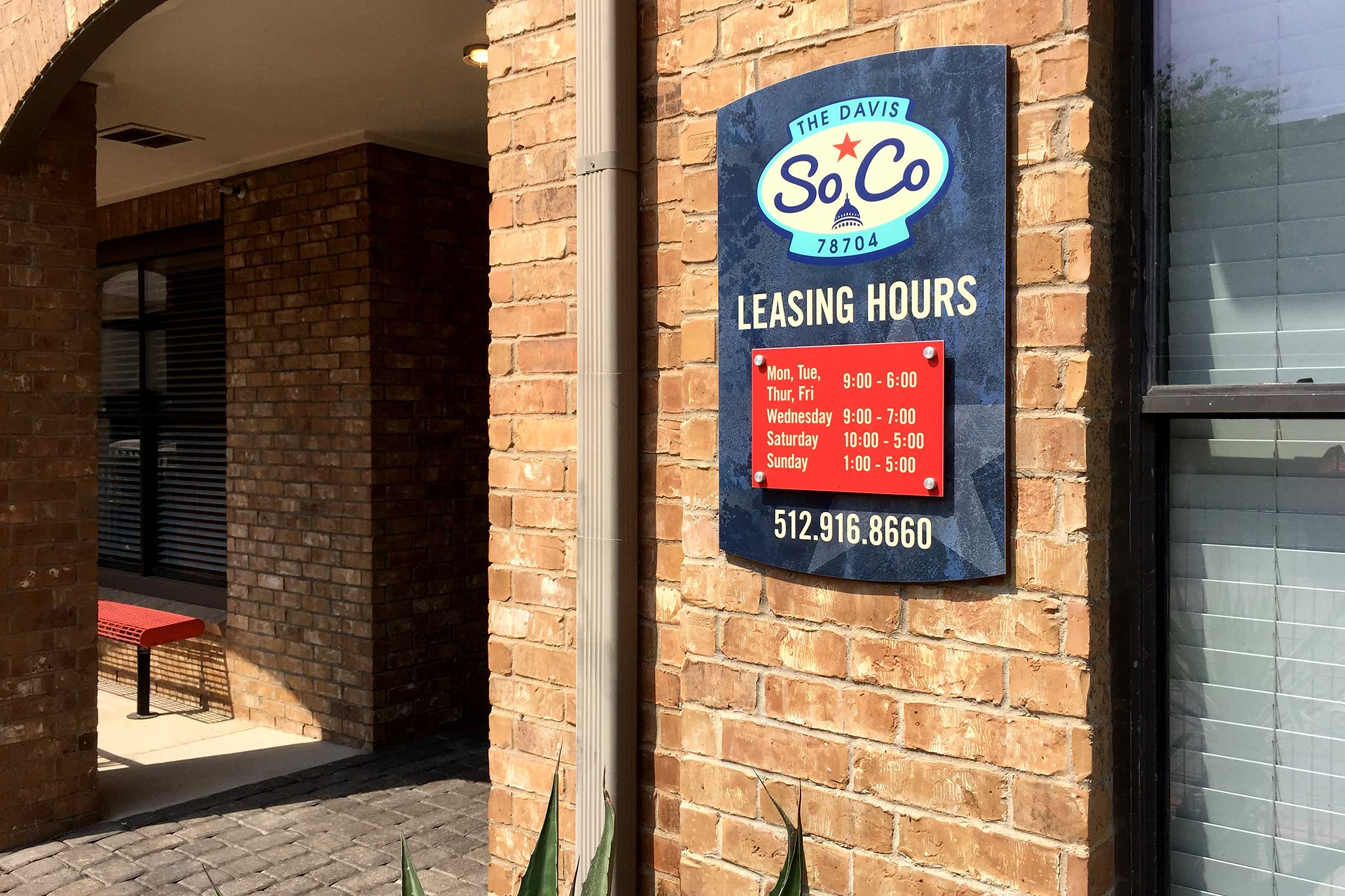 The Davis Soco Apartments Office Hours Sign