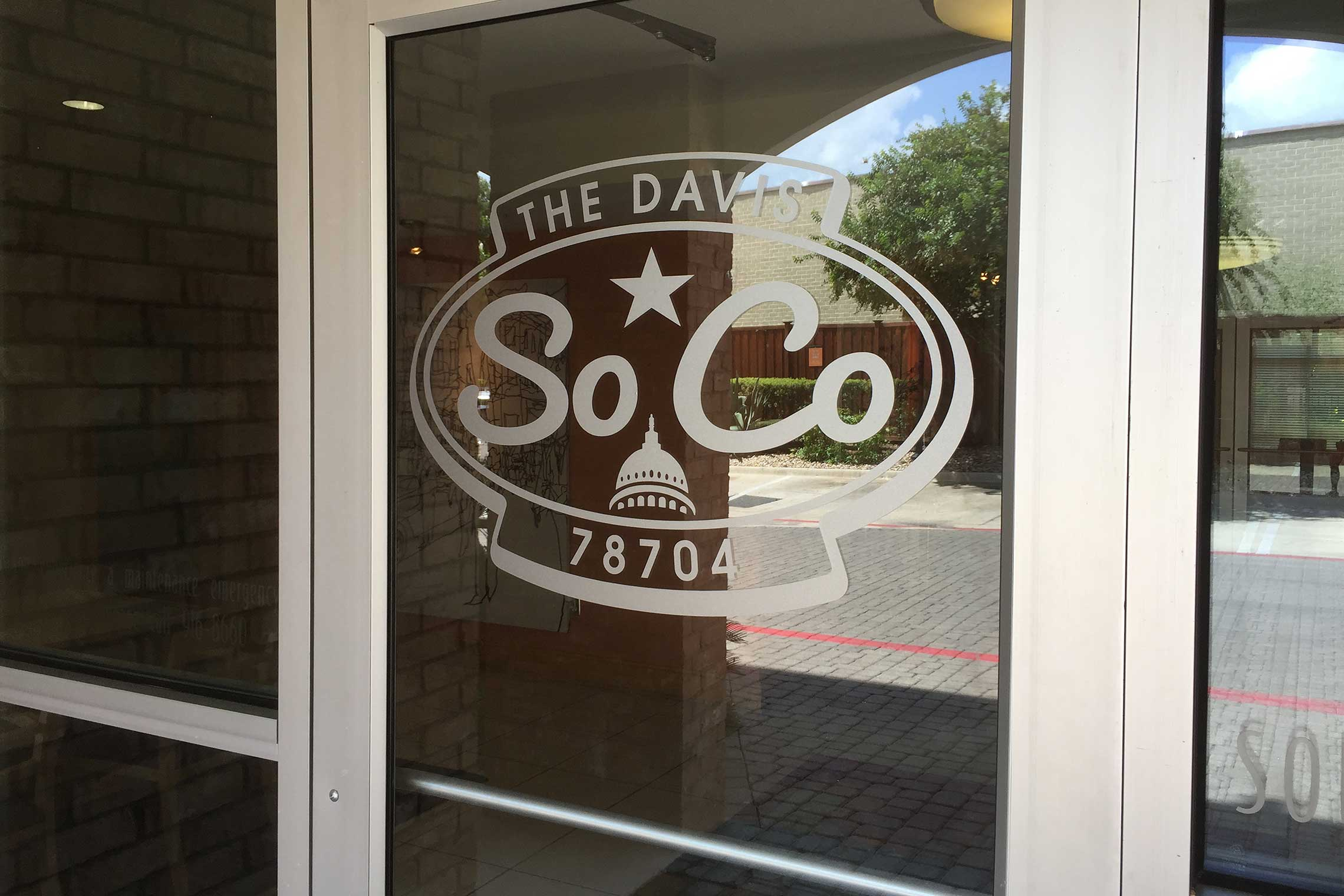 The Davis Soco Apartments Leasing Center Door Vinyl Logo