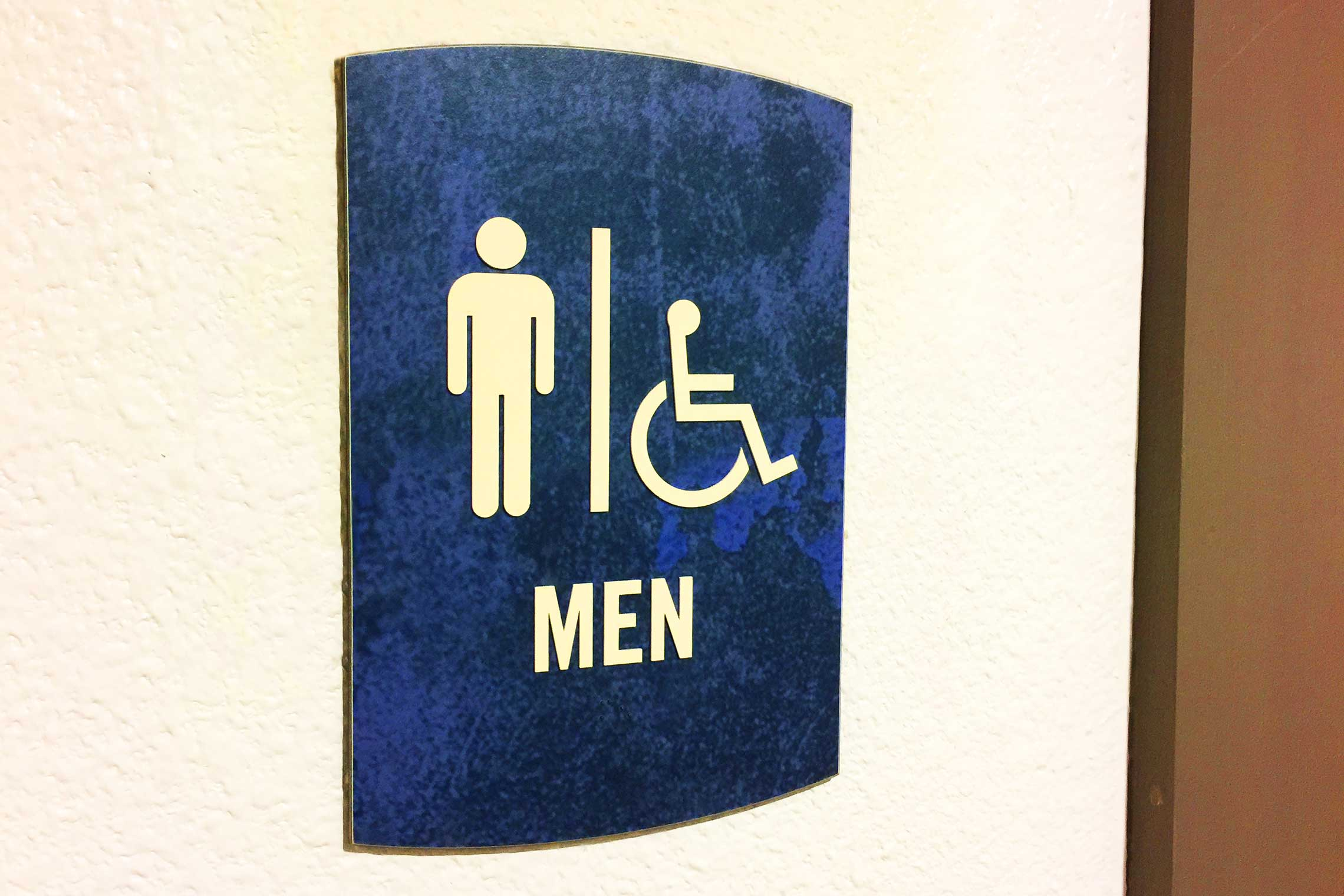 The Davis Soco Apartments Men Restroom Sign