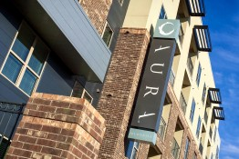 Aura Memorial Apartments LED Illuminated Identity Blade Sign on Building