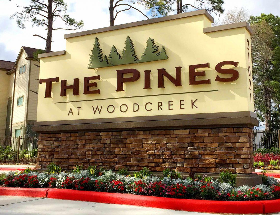 The Pines at Woodcreek Apartments LED Illuminated Monument on Masonry Base